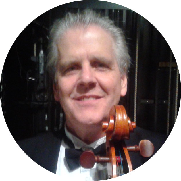 Tom Austin in a tuxedo holding a cello